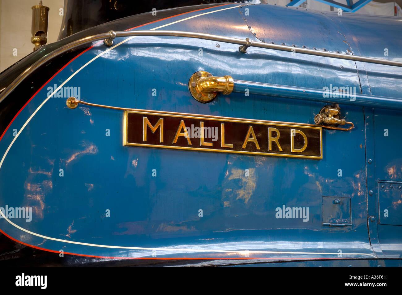 Close up horizontal photo of Mallard steam train nameplate at National Railway Museum York UK - Stock Image