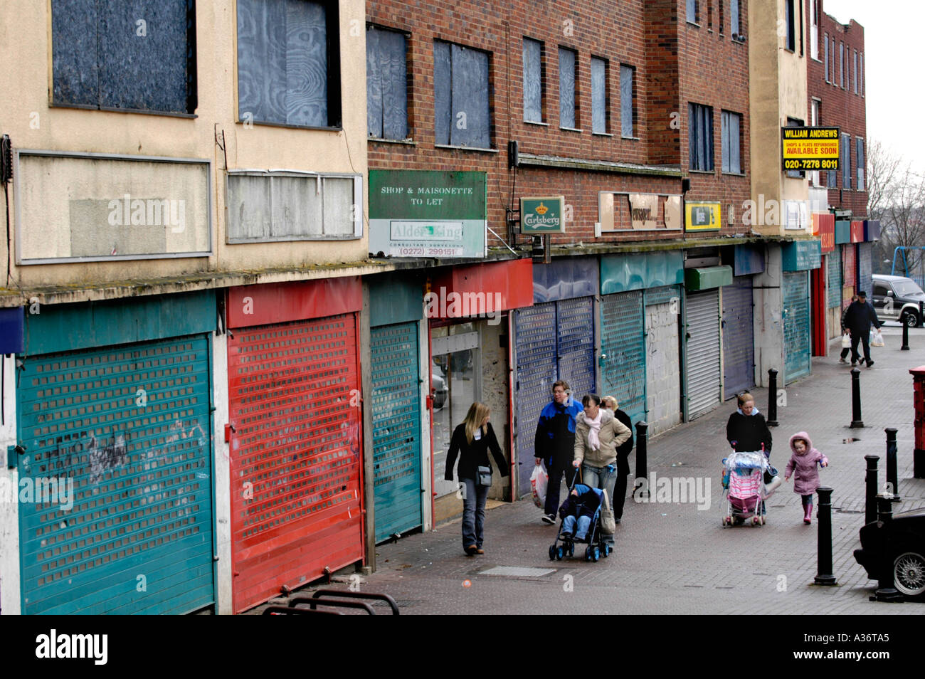 urban decay uk Boarded up shuttered shops and flats Symes Avenue Hartcliffe Bristol in urgent need of redevelopment England UK - Stock Image