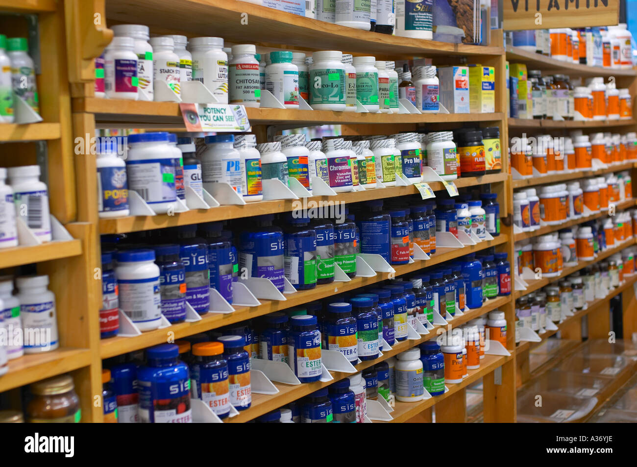 Health food and supplements shop. Vitamins and supplements lined up on store shelves. Stock Photo