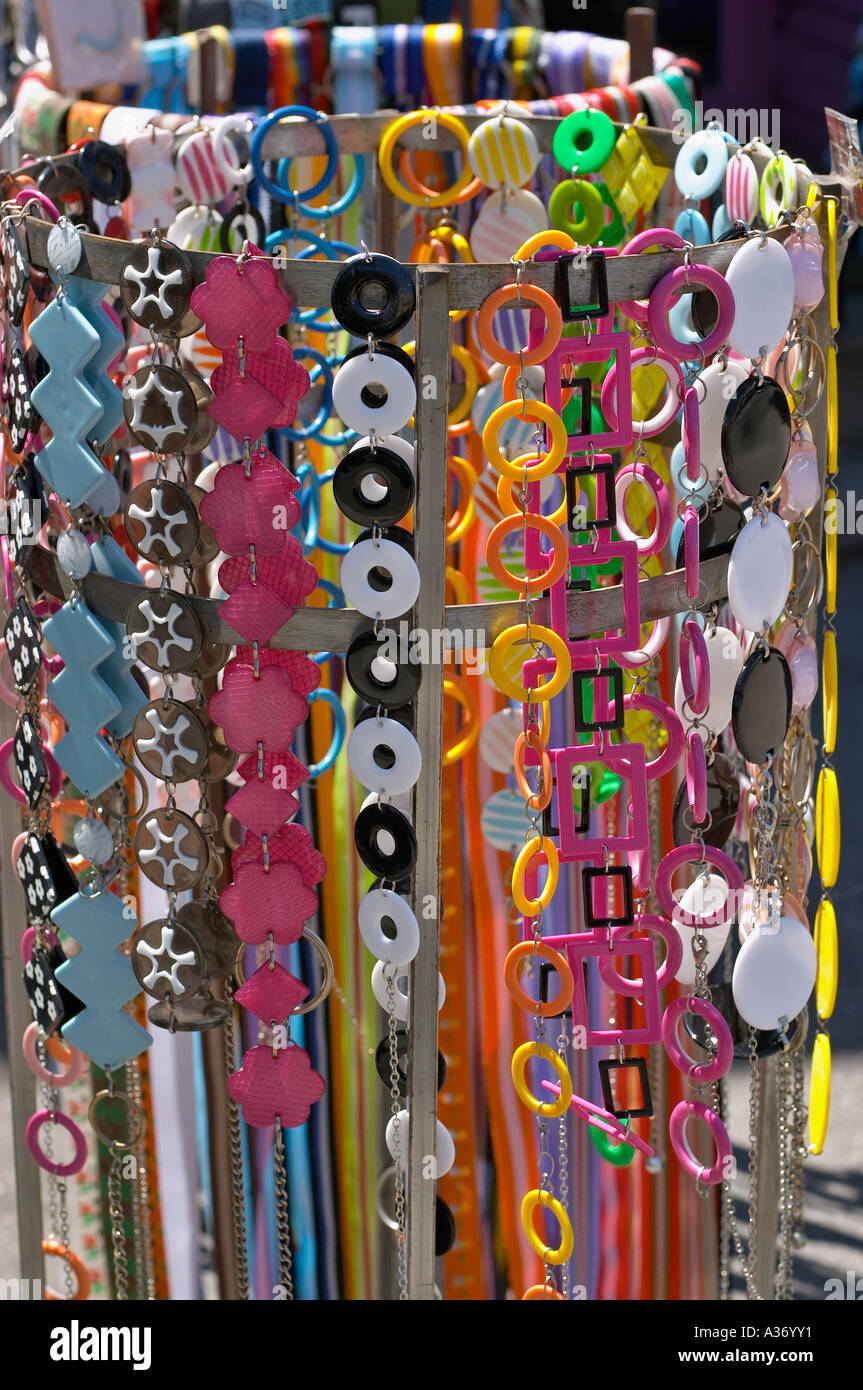 Fun and stylish 80's fashions are back! Plastic and vinyl belts on a sales rack. - Stock Image