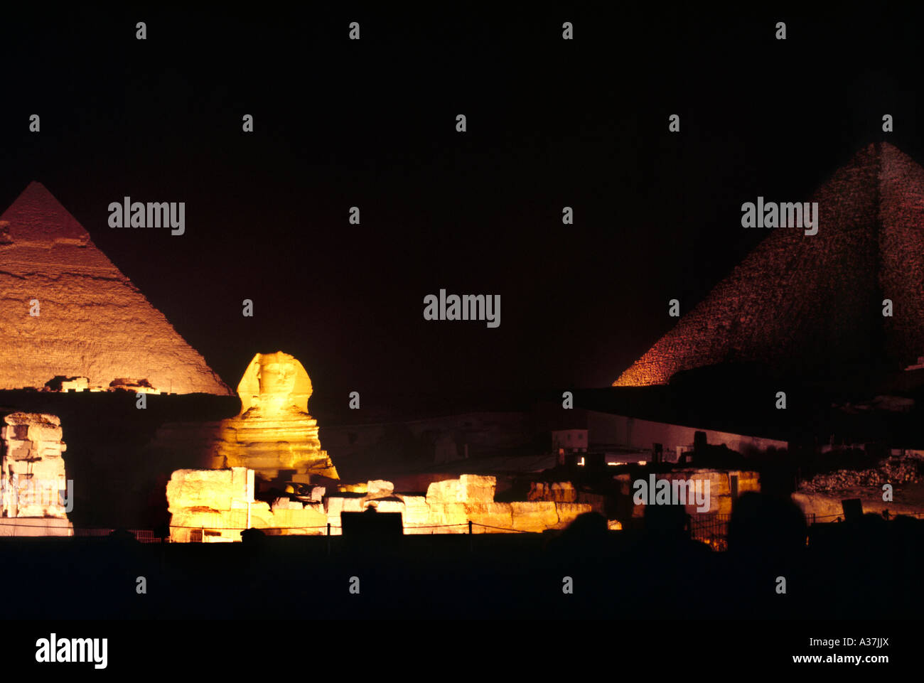 Giza Egypt Sphinx And Pyramid Of Cheops At Night - Stock Image