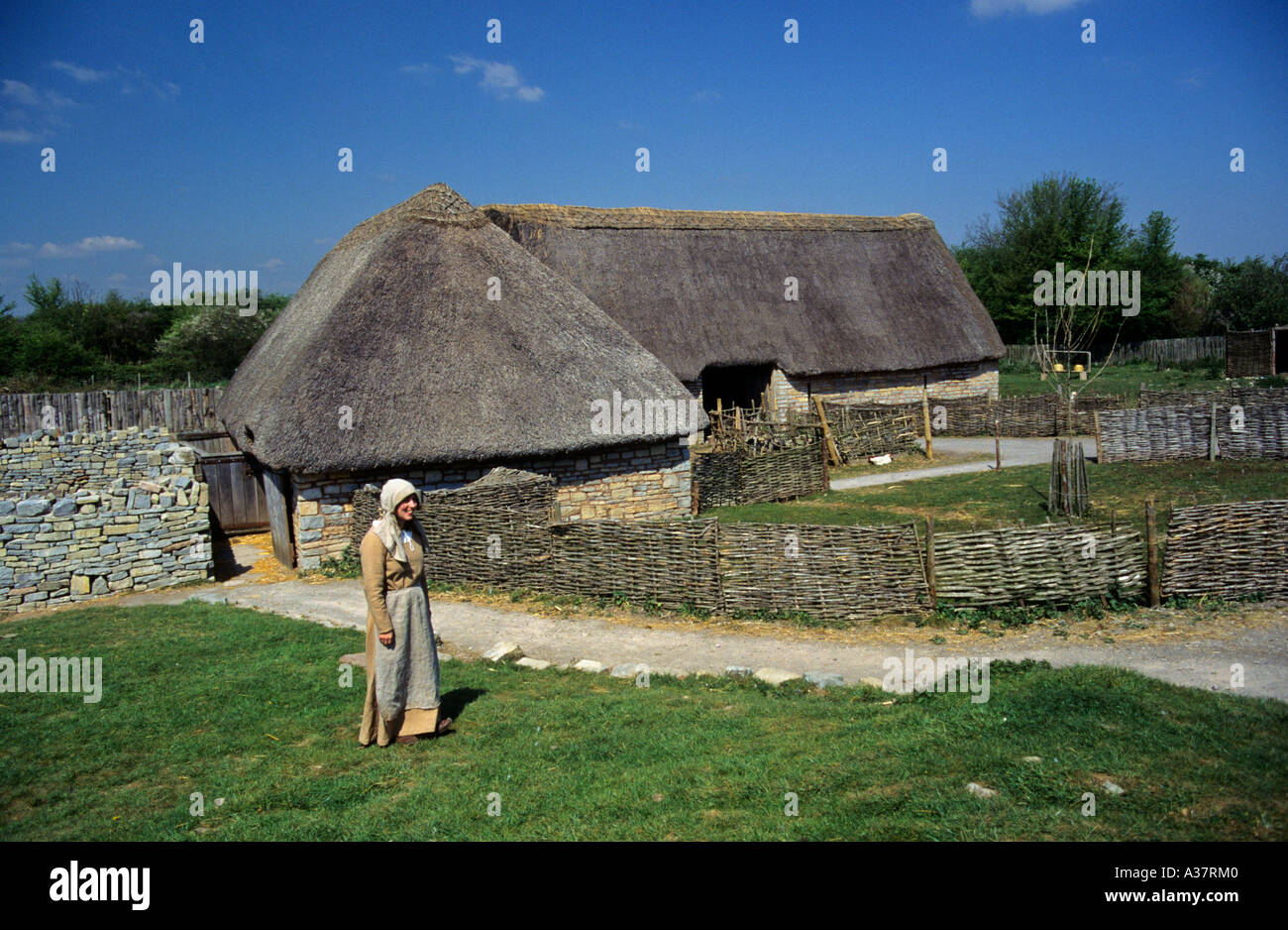 Tourist guide in period costume at Cosmeston Medieval Village Cardiff Wales UK - Stock Image