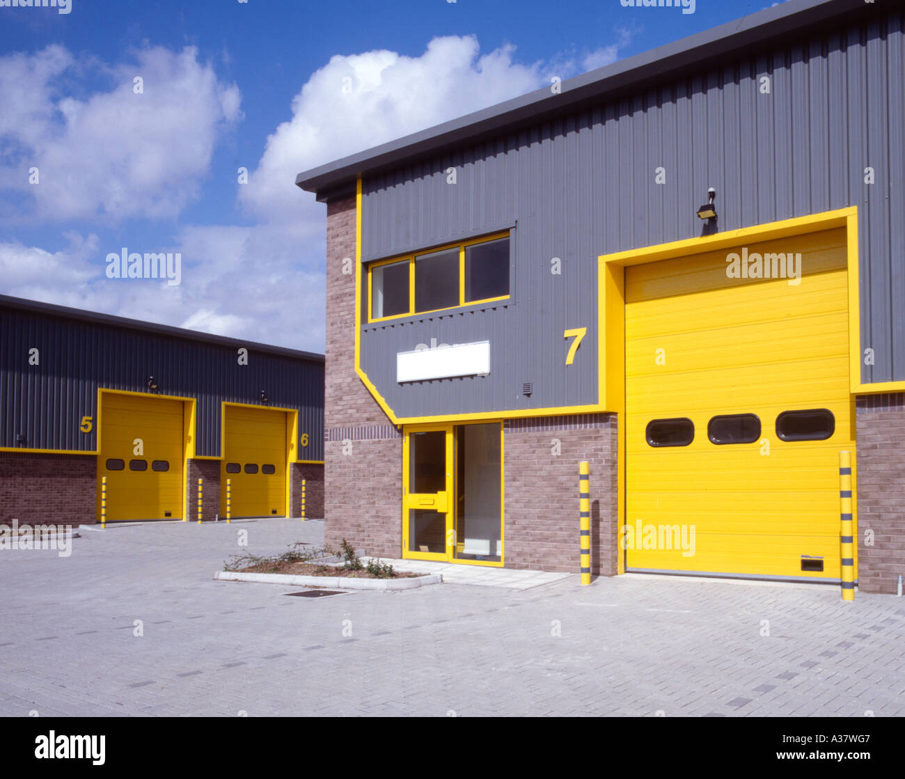 Yellow doors of new industrial units on Medway industrial Estate Strood Kent & Yellow doors of new industrial units on Medway industrial Estate ...