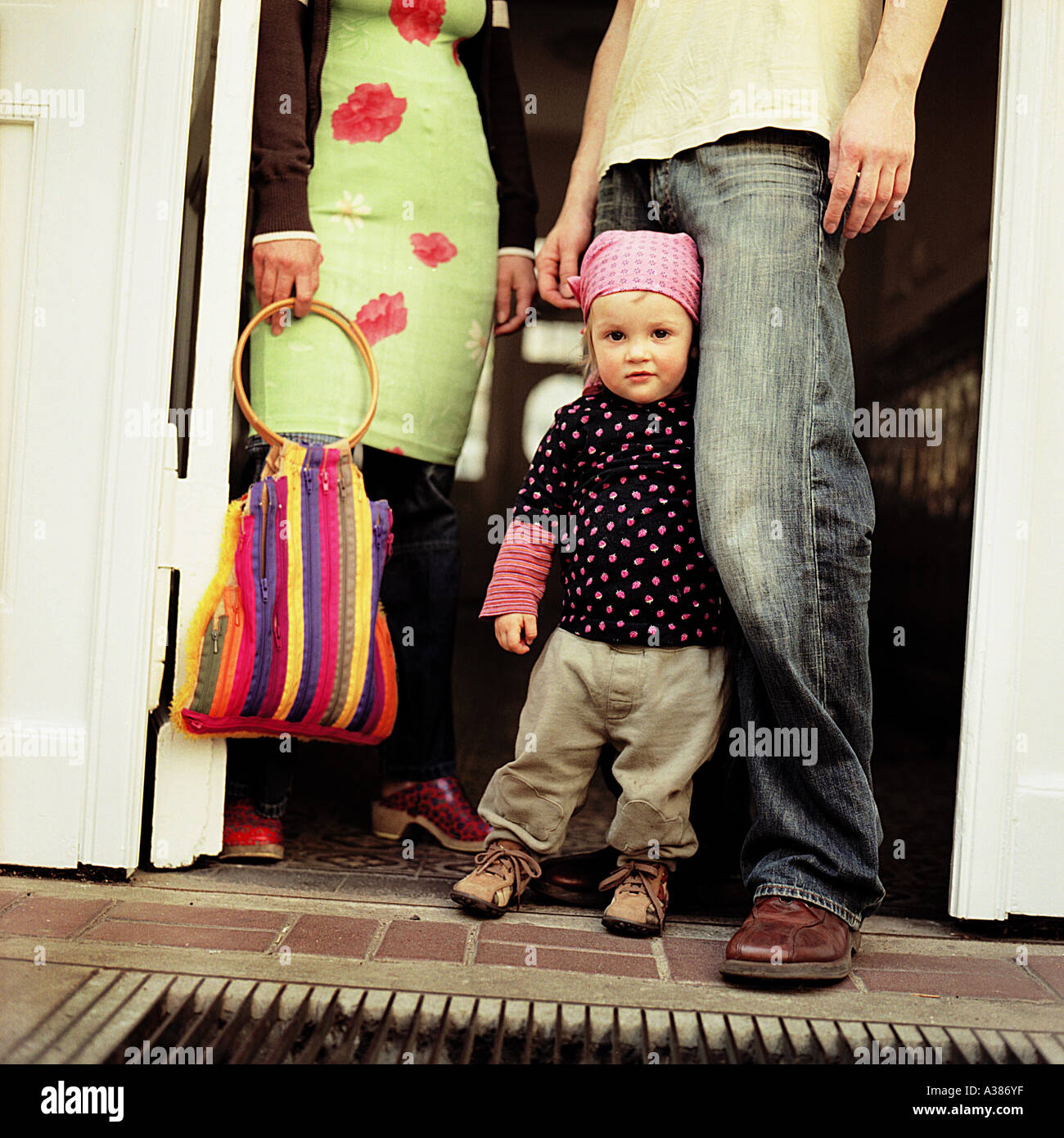 family with child before leaving their townflat - Stock Image