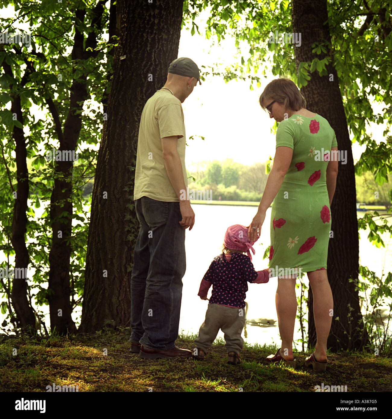 family with child watchs the river Spree - Stock Image