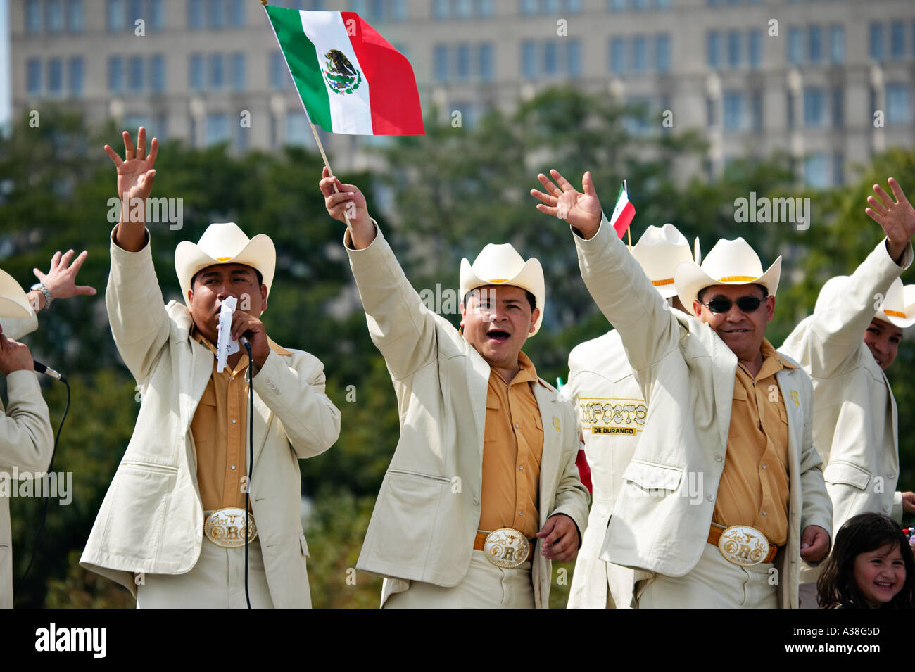 fc18983f4e774 ILLINOIS Chicago Members of Hispanic singing group wave Mexican flag  matching suits cowboy hats