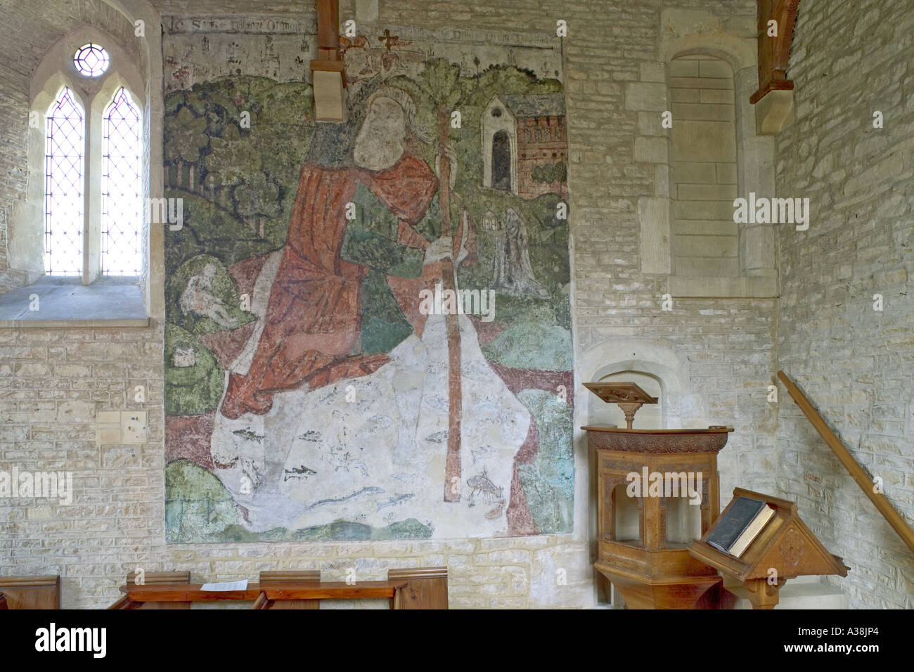 14th century wall painting of St Christopher in the church of St Mary Magdelene at Baunton in Gloucestershire - Stock Image
