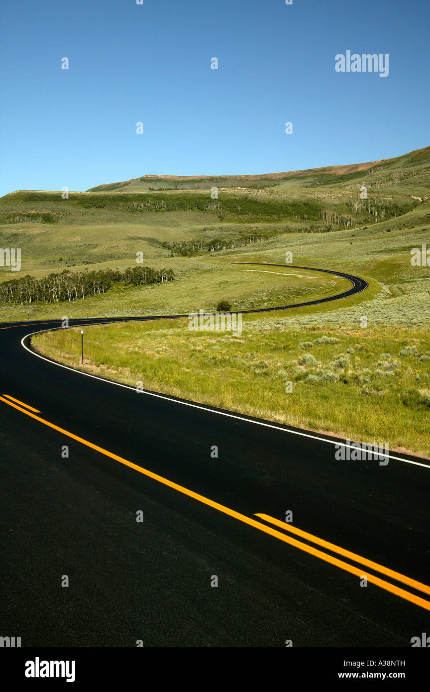 Highway curves with orange center striping, Utah - Stock Image