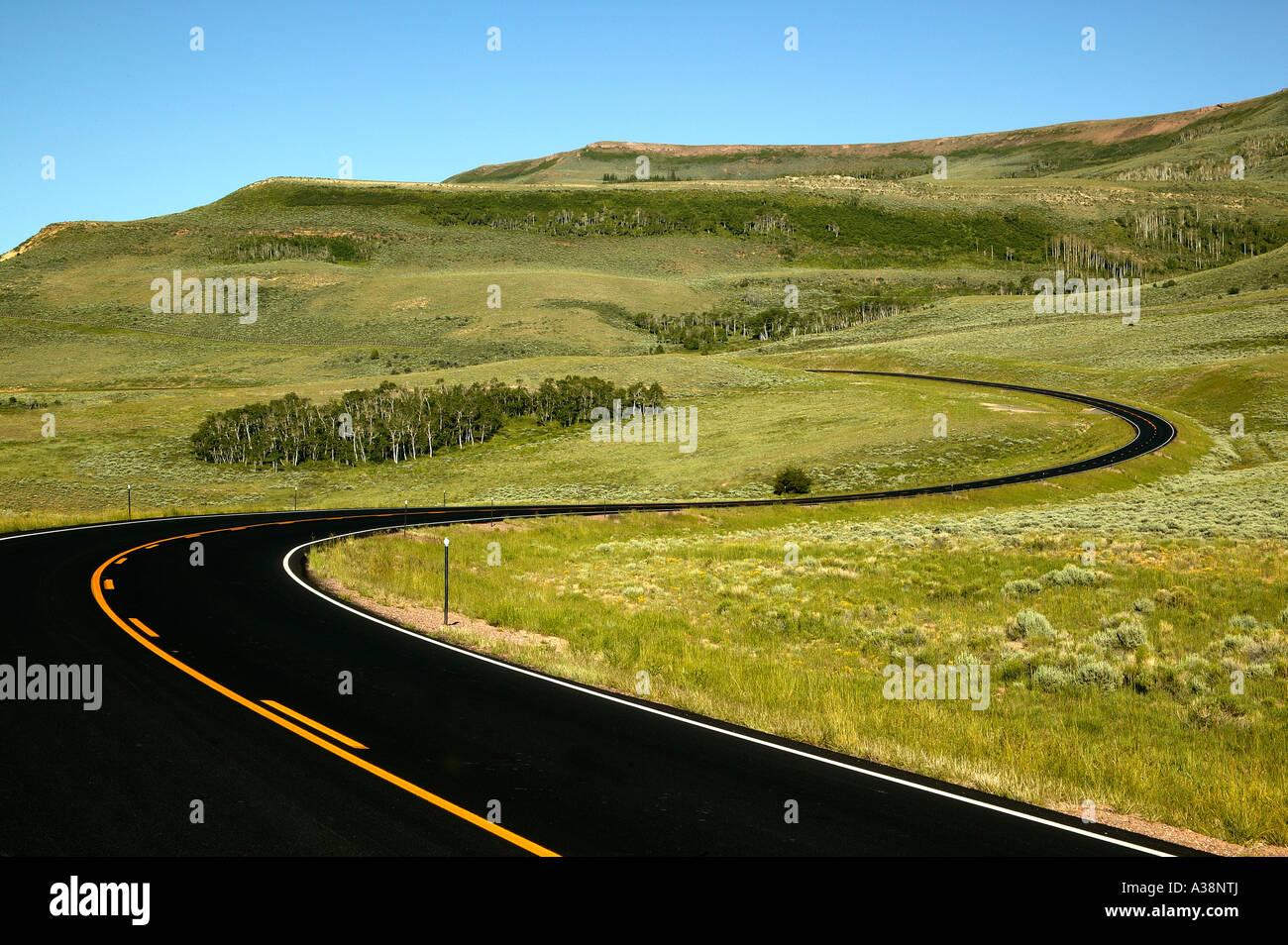 Highway curves with orange center striping, Utah - Stock Image