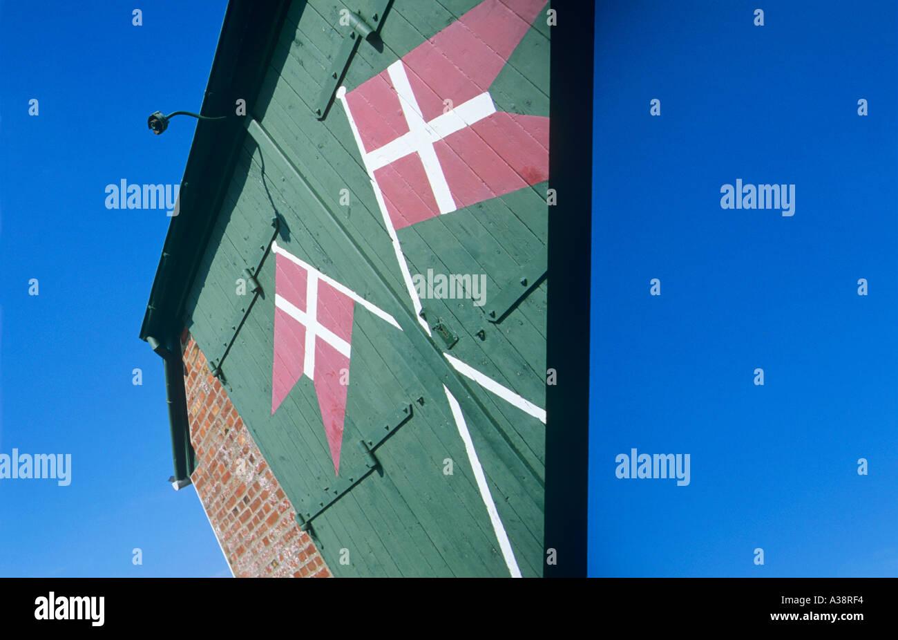 DANISH FLAGS ON GREEN DOOR - Stock Image