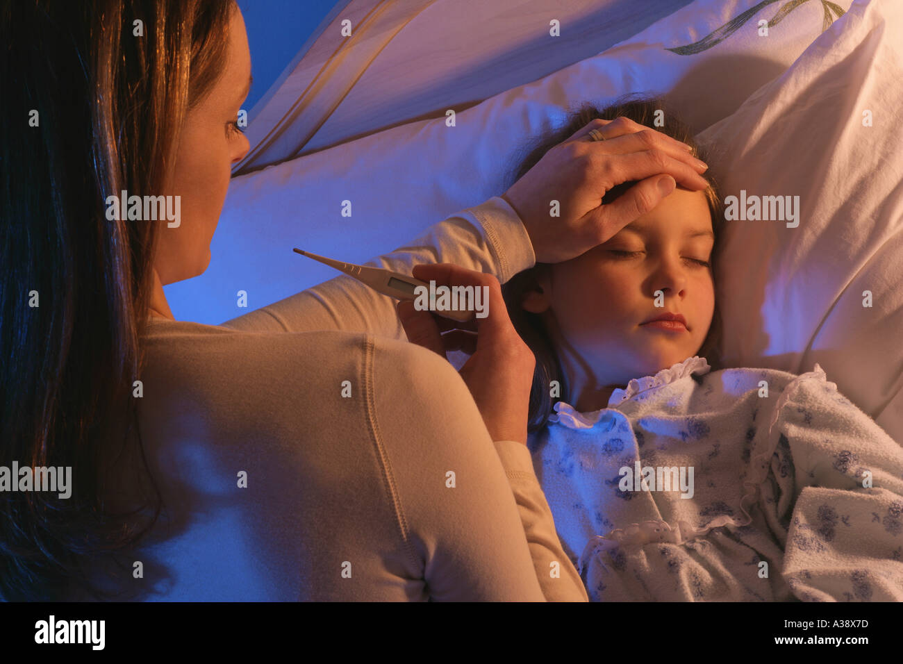 Mother tending to sick child - Stock Image