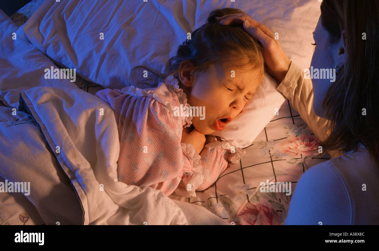 Mother beside sick child - Stock Image