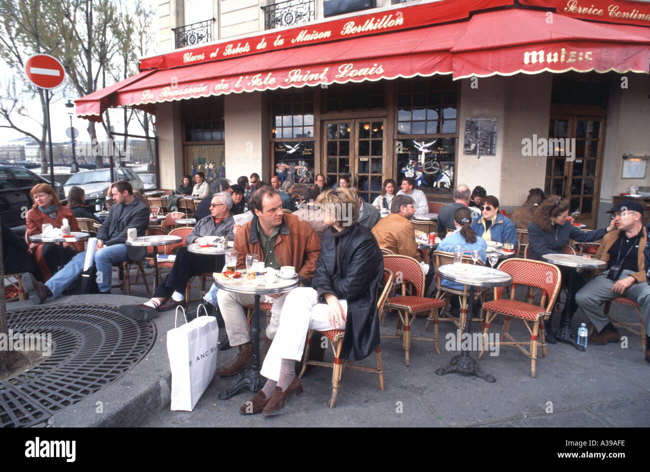 Paris France Couple At Table On Terrace At French Brasserie