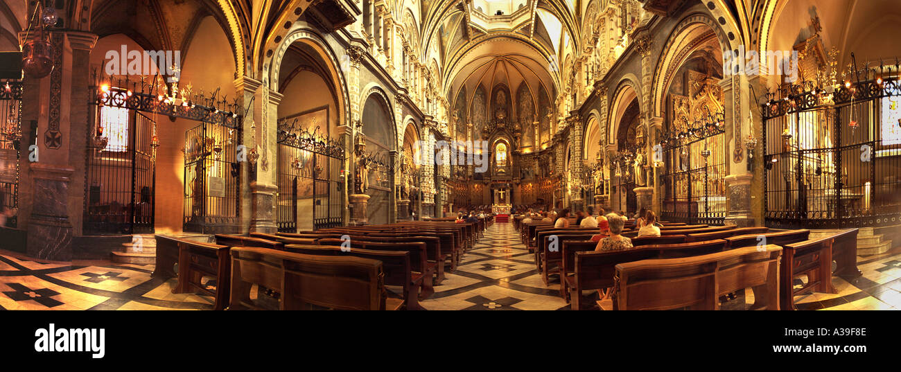 Cathedral Montserrat Mountain Basilica,  church interior Architecture Interior with  people Praying in Church Stock Photo