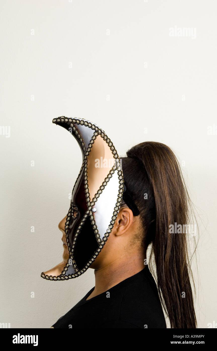 Teen wearing moon mask - Stock Image