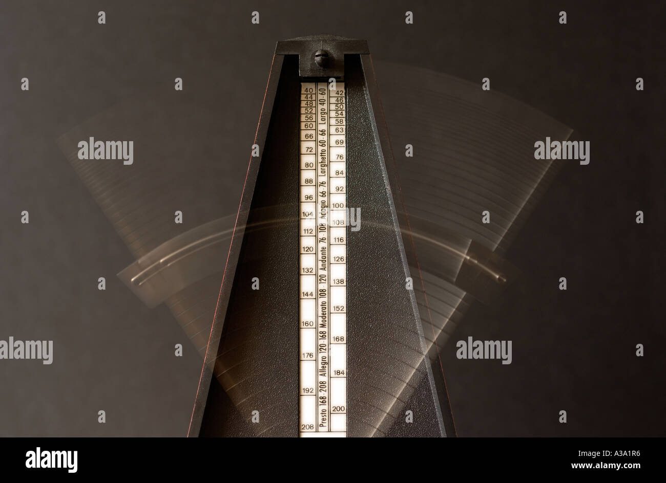 Blurred moving arm on a musicians mechanical metronome. Credit: Malcolm Park/Alamy. - Stock Image