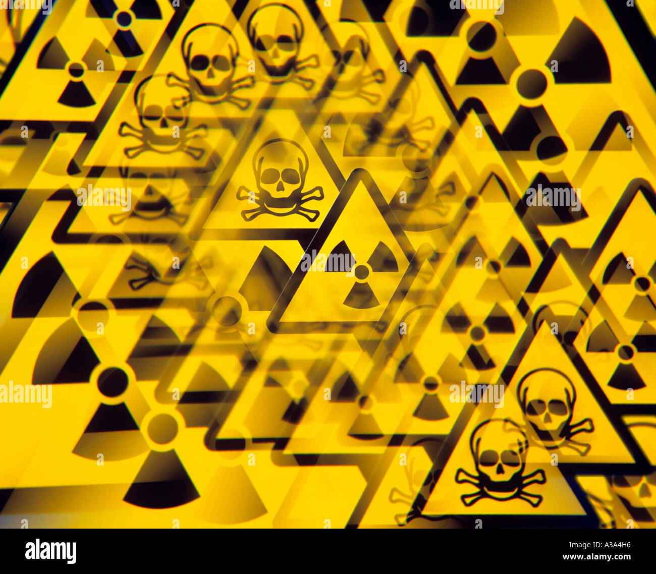 Photograph of hazard warning symbols, including a 'skull and cross bones' image and a trefoil radiation warning sign. - Stock Image