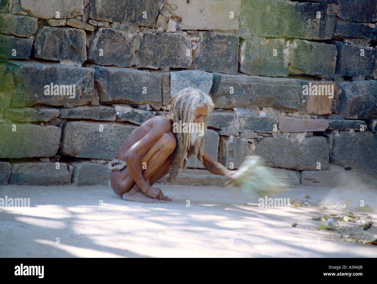 Khajuraho India Sweeping Temple Grounds As Act Of Piety Menial Job - Stock Image