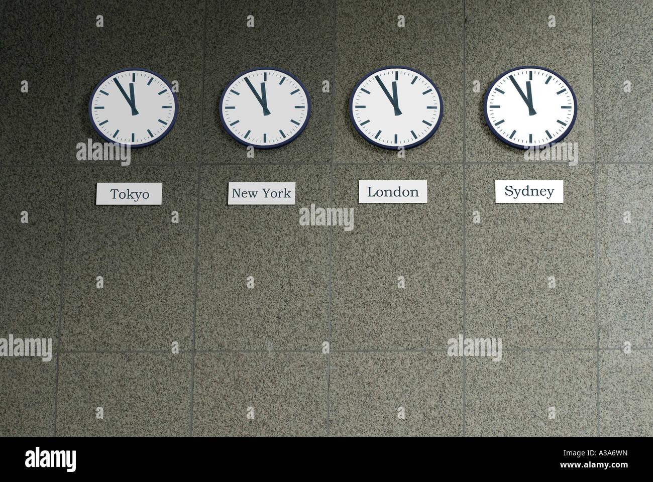 134d0125186 four clocks on five to twelve Tokyo New York London Sydney Stock ...