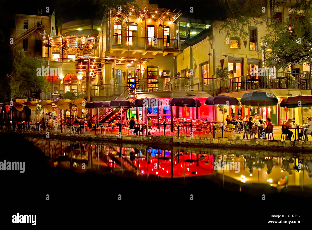 San Antonio Texas River Walk At Night With Christmas Lights Reflecting On  The Water. Festive And Colorful.