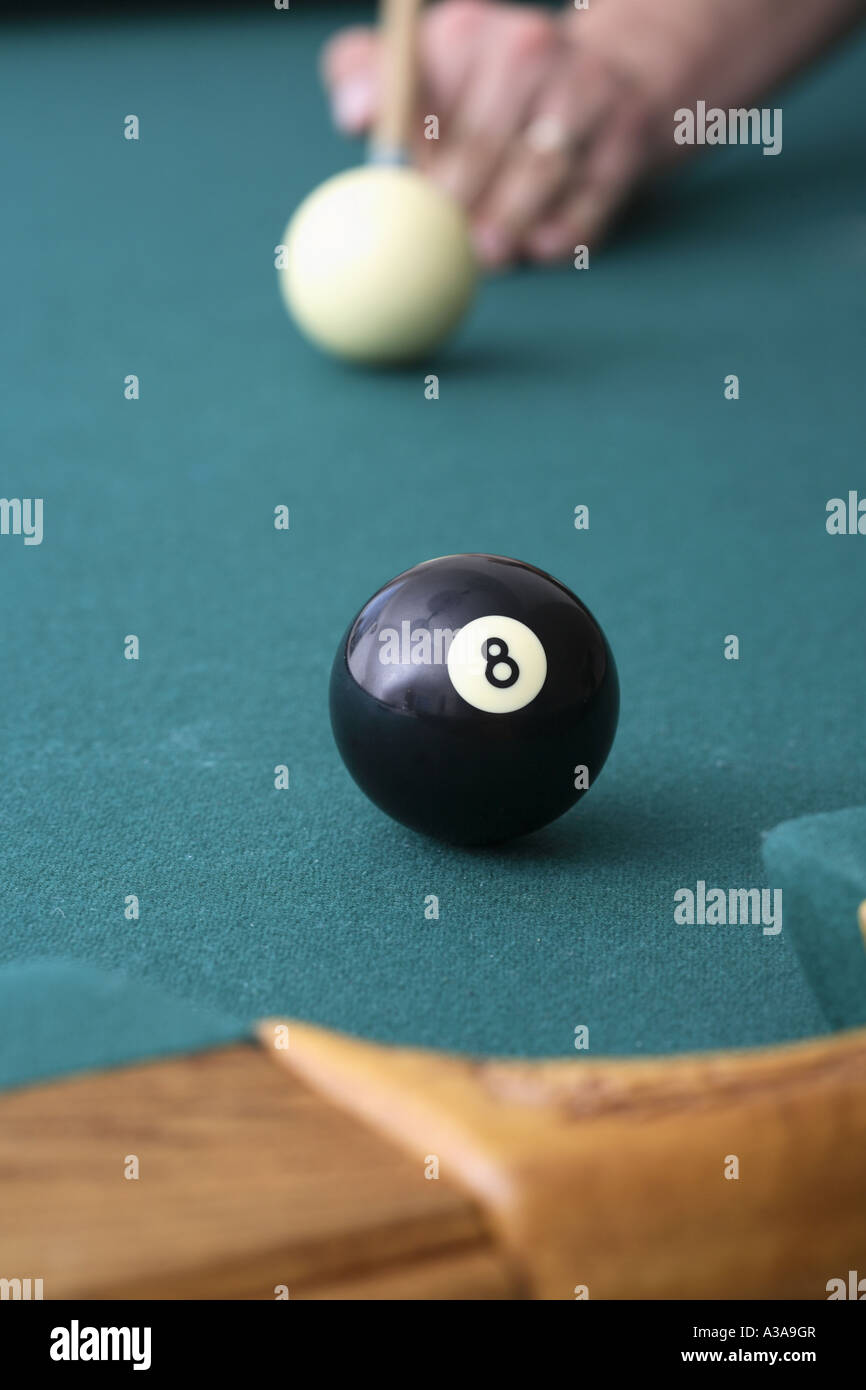 Final shot of a pool game with eight ball in focus Stock Photo