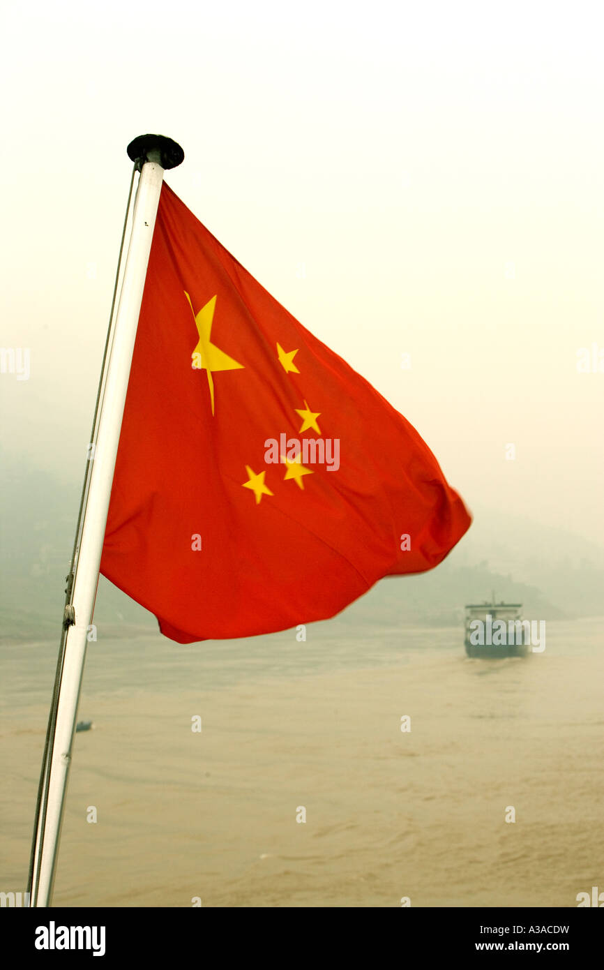 Chinese flag flying off stern of tourboat, Yangtze River, China - Stock Image