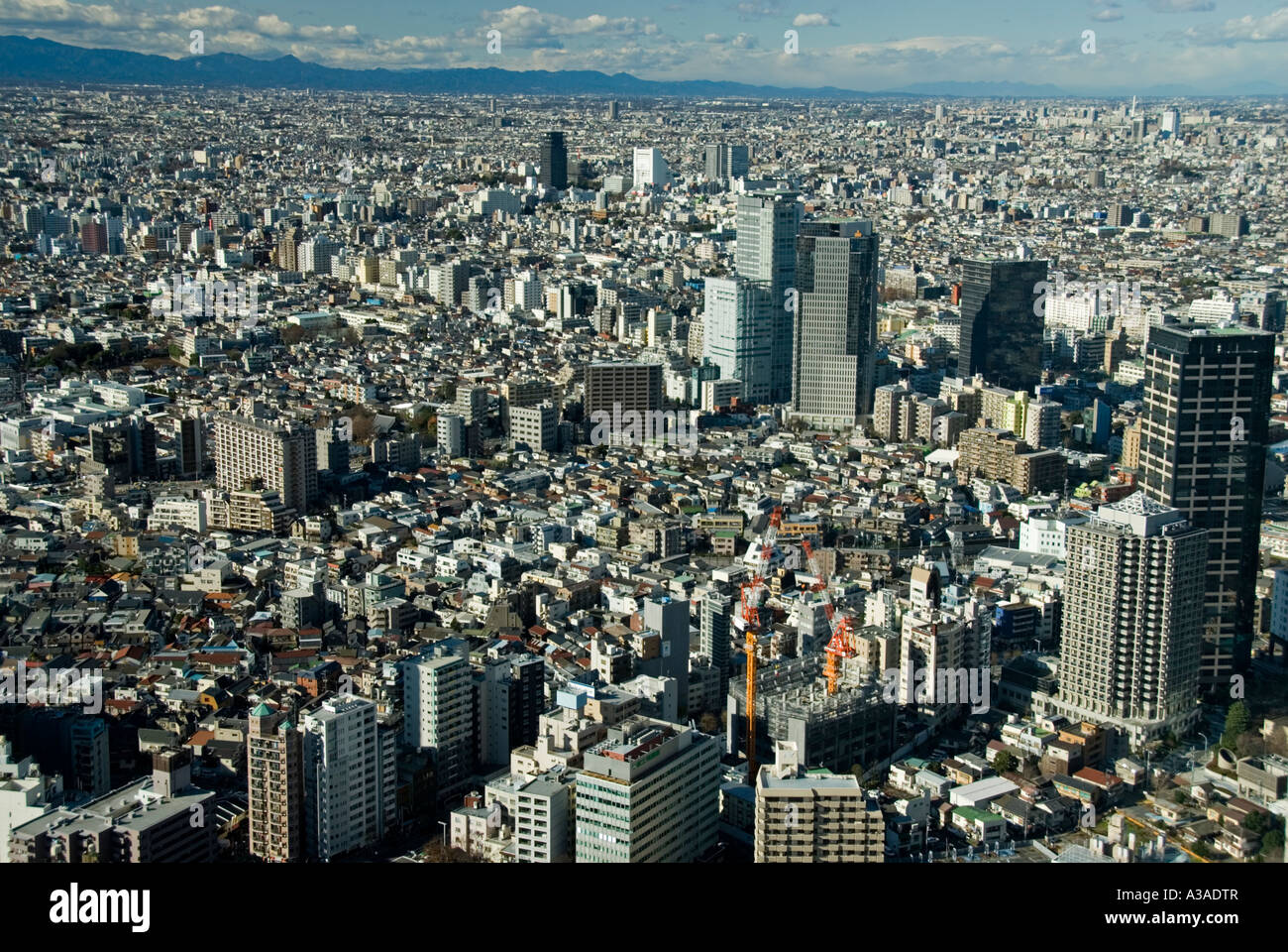 View over Tokyo from top of metropolitan goverment office in Shinjuku district - Stock Image