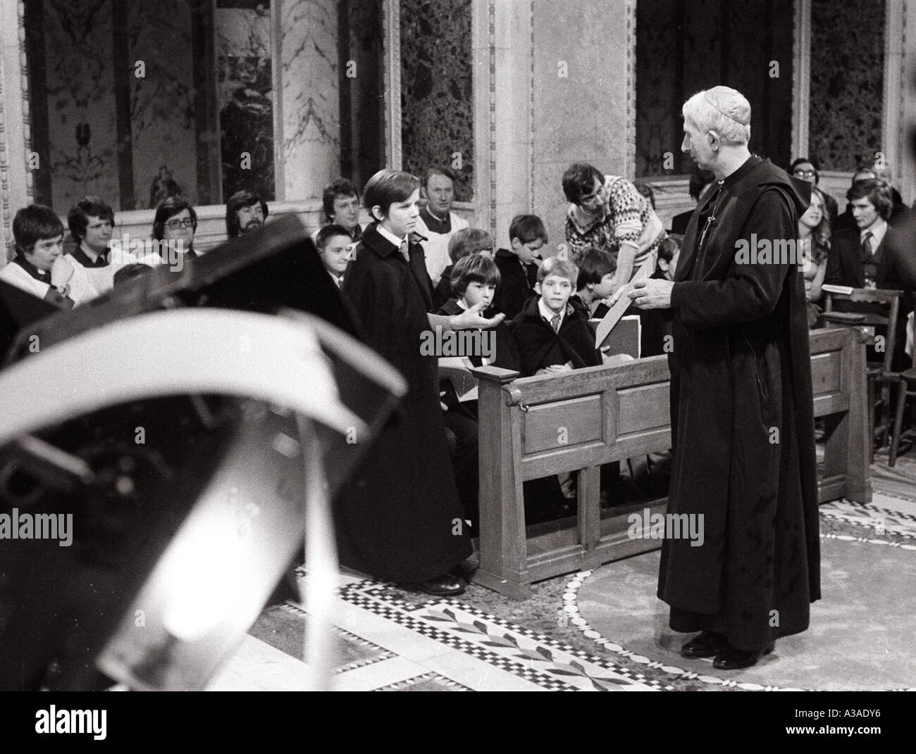 Cardinal Basil Hume Archbishop of Westminster looks on at Relersal for TV production in Cathedral - Stock Image