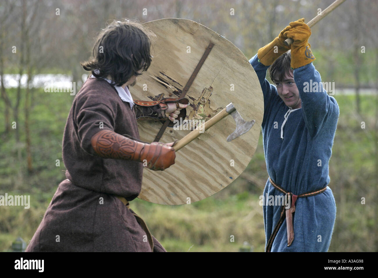 iron age reinactor role players in costume battle shields axes ecos centre ballymena st Patrick s day county antrim - Stock Image