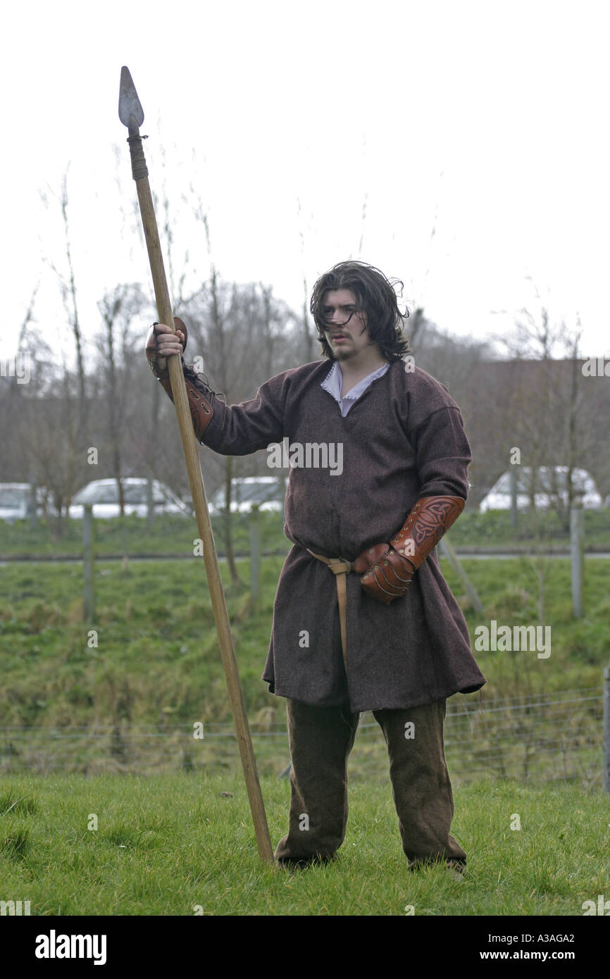 iron age reinactor role player in costume with long spear ecos centre ballymena st patricks day county antrim northern ireland - Stock Image