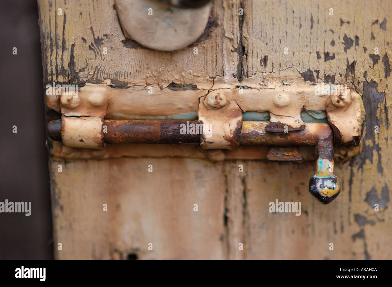 Close up of a an old door with bolt type lock Stock Photo