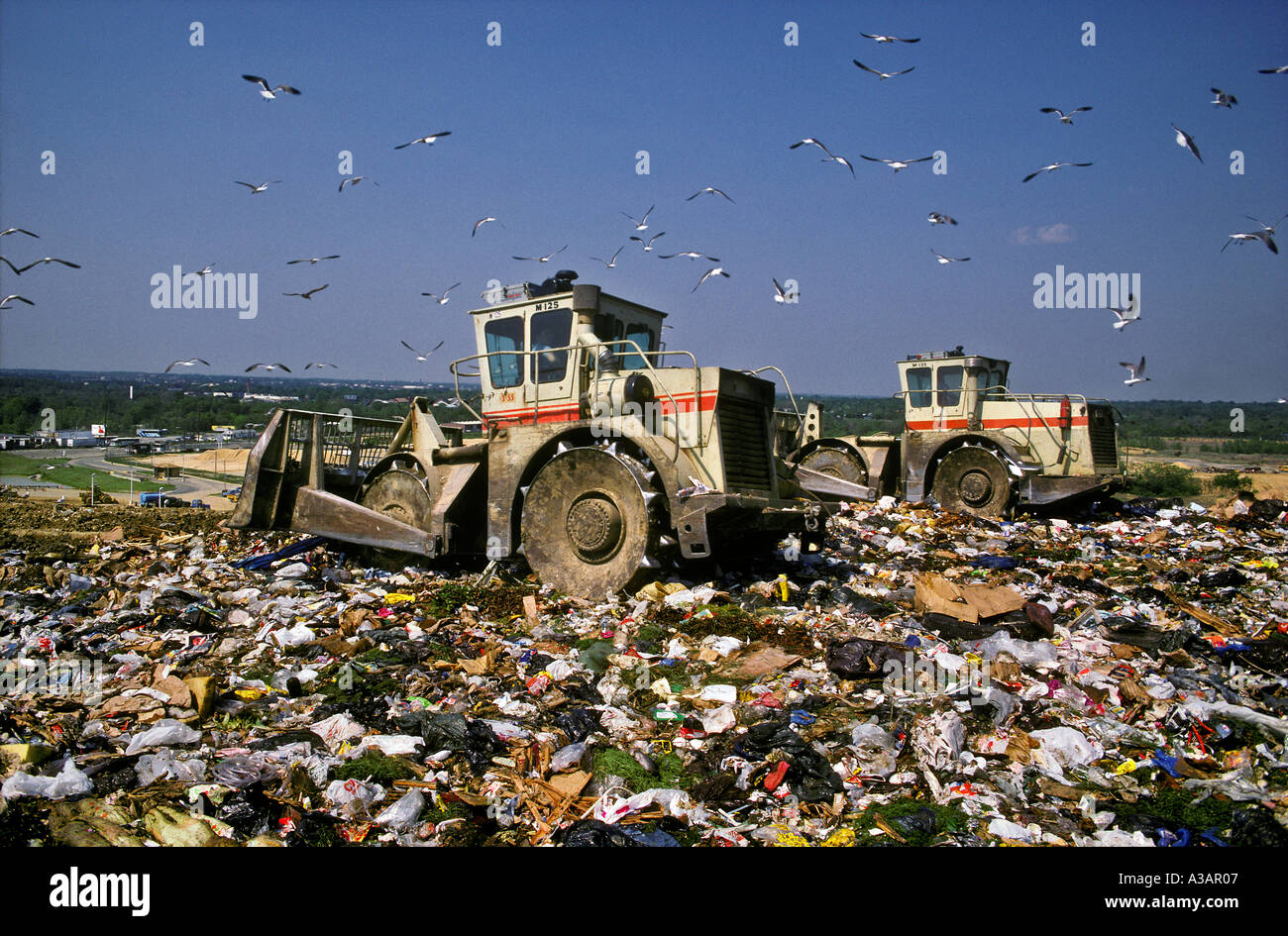 Sheeps Feet Dozers Spread the Refuse on Landfill PA - Stock Image