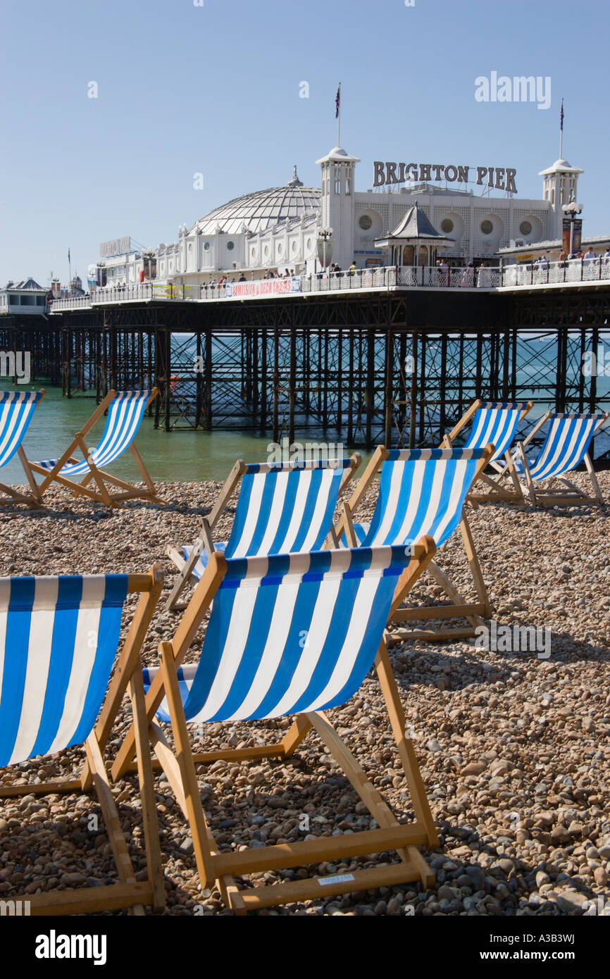 ENGLAND East Sussex Brighton Pier and Beach with empty deck chairs on pebble shingle beach - Stock Image