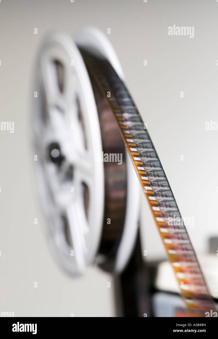 Amateur 8mm cine film on projector reel with shallow depth of field focused on a few frames of film - Stock Image
