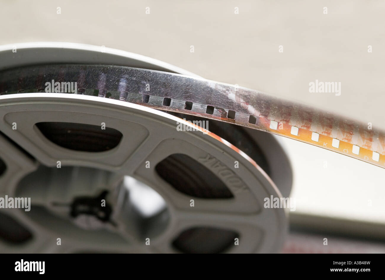 Amateur 8mm cine film on projector reel showing damage from age and fungal growth - Stock Image