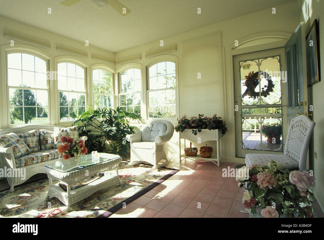 Glassed In Porch With White Wicker Furniture And Tile Floor Missouri