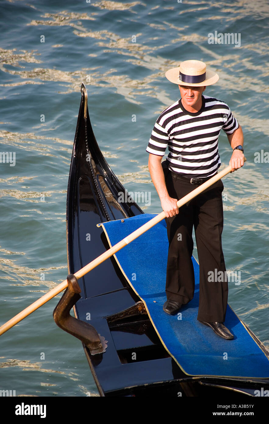 664d982f4f9 ITALY Veneto Venice Gondolier wearing striped t-shirt and straw boater hat  rowing his gondola