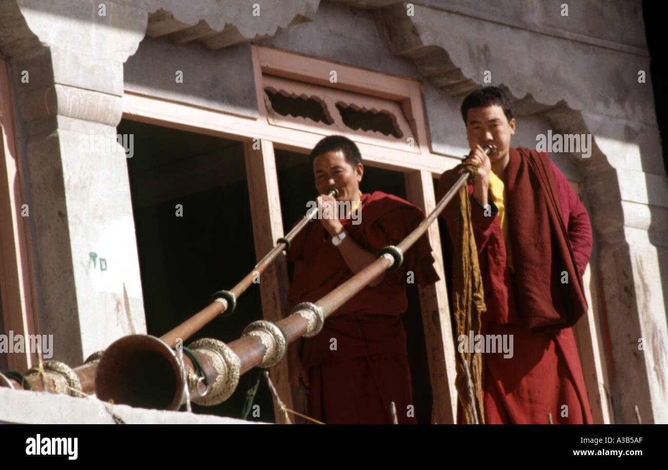 Monks playing a tratitional musucal instrument Gompa Tawang Arunachal Pradesh India - Stock Image