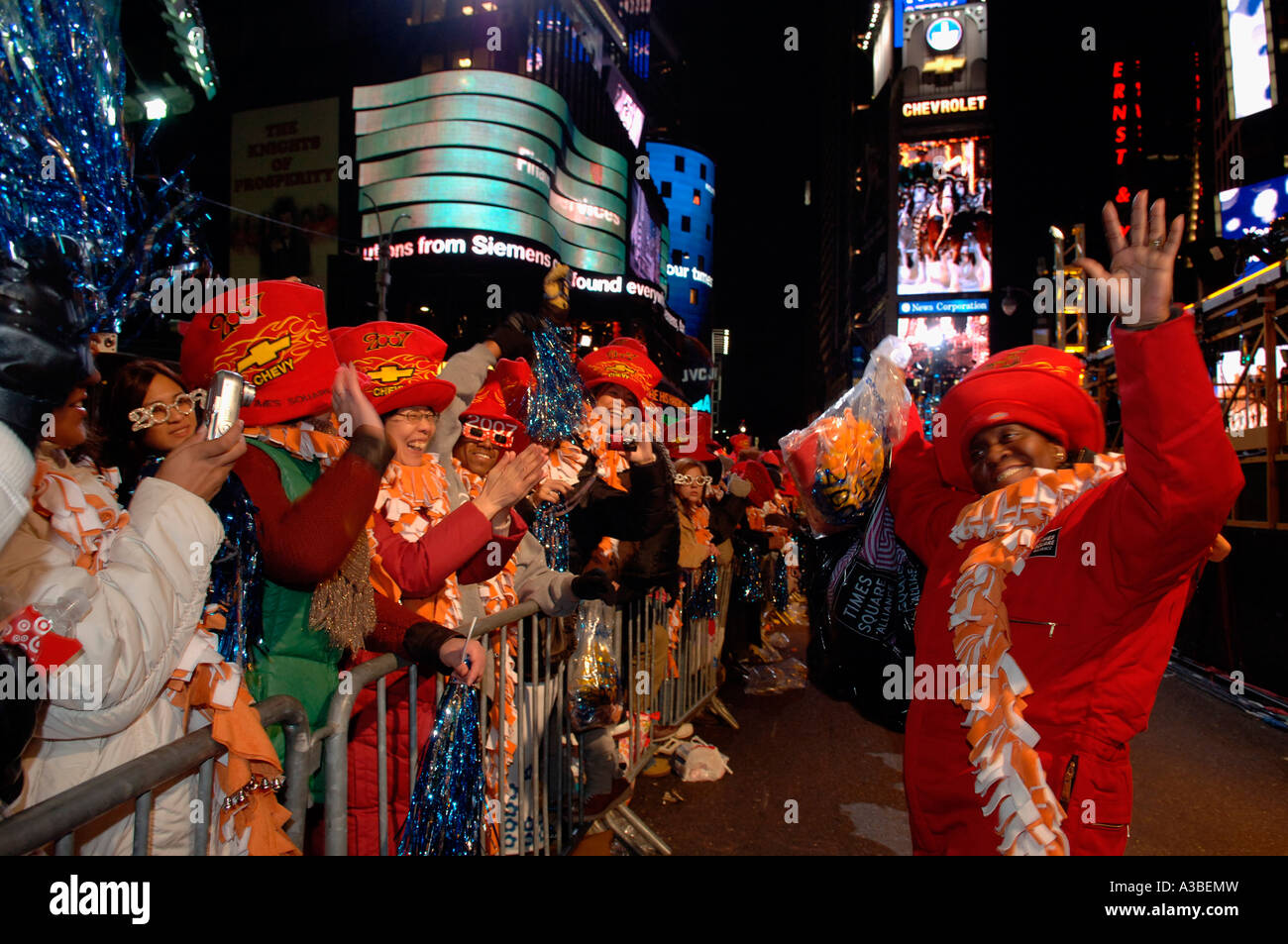 An employee of the Times Square Alliance entertains some spectators in Times Square on New Year s Eve Stock Photo