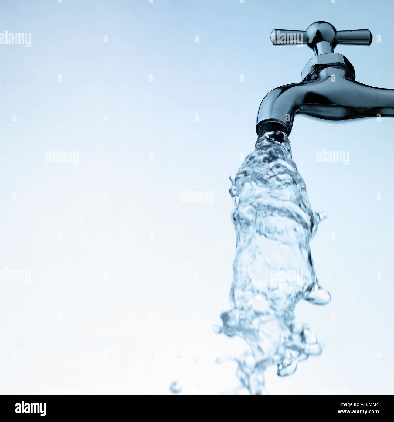 A water tap spouting watercourse - Stock Image