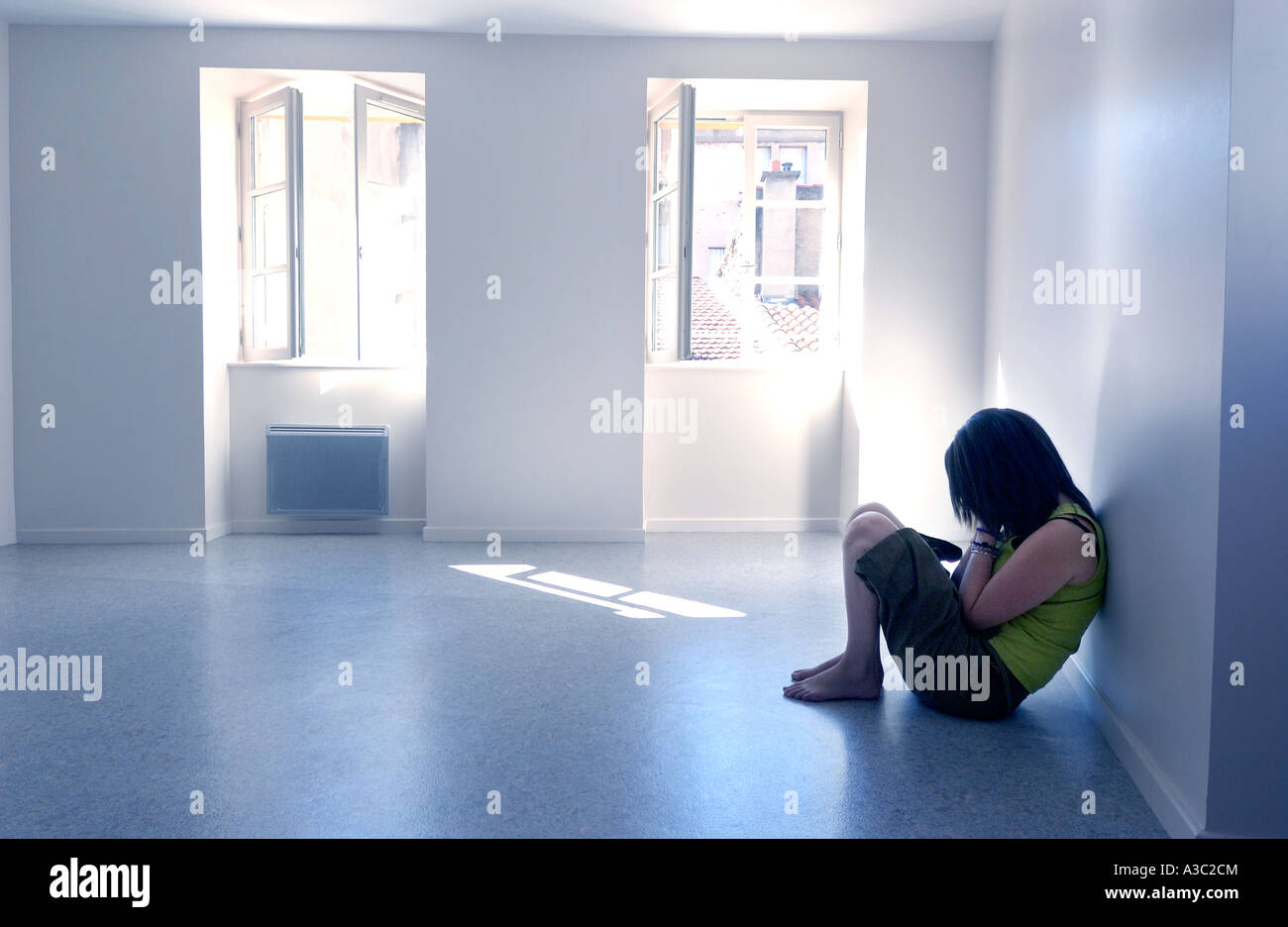 Girl / teenager / young woman - loneliness, depression, mental health concept - Stock Image