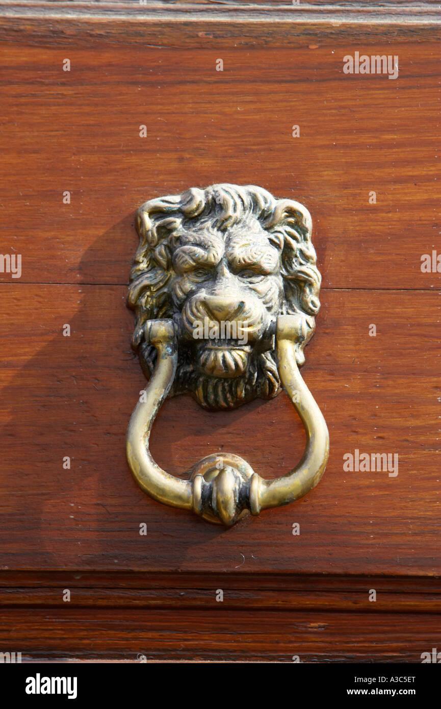 traditional antique brass lion head door knocker on wooden door Tenerife  Canary Islands Spain - Traditional Antique Brass Lion Head Door Knocker On Wooden Door