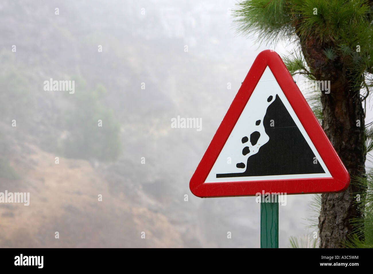 loose falling rocks warning triangular roadsign on the mountain road to El Teide Tenerife Canary Islands Spain - Stock Image