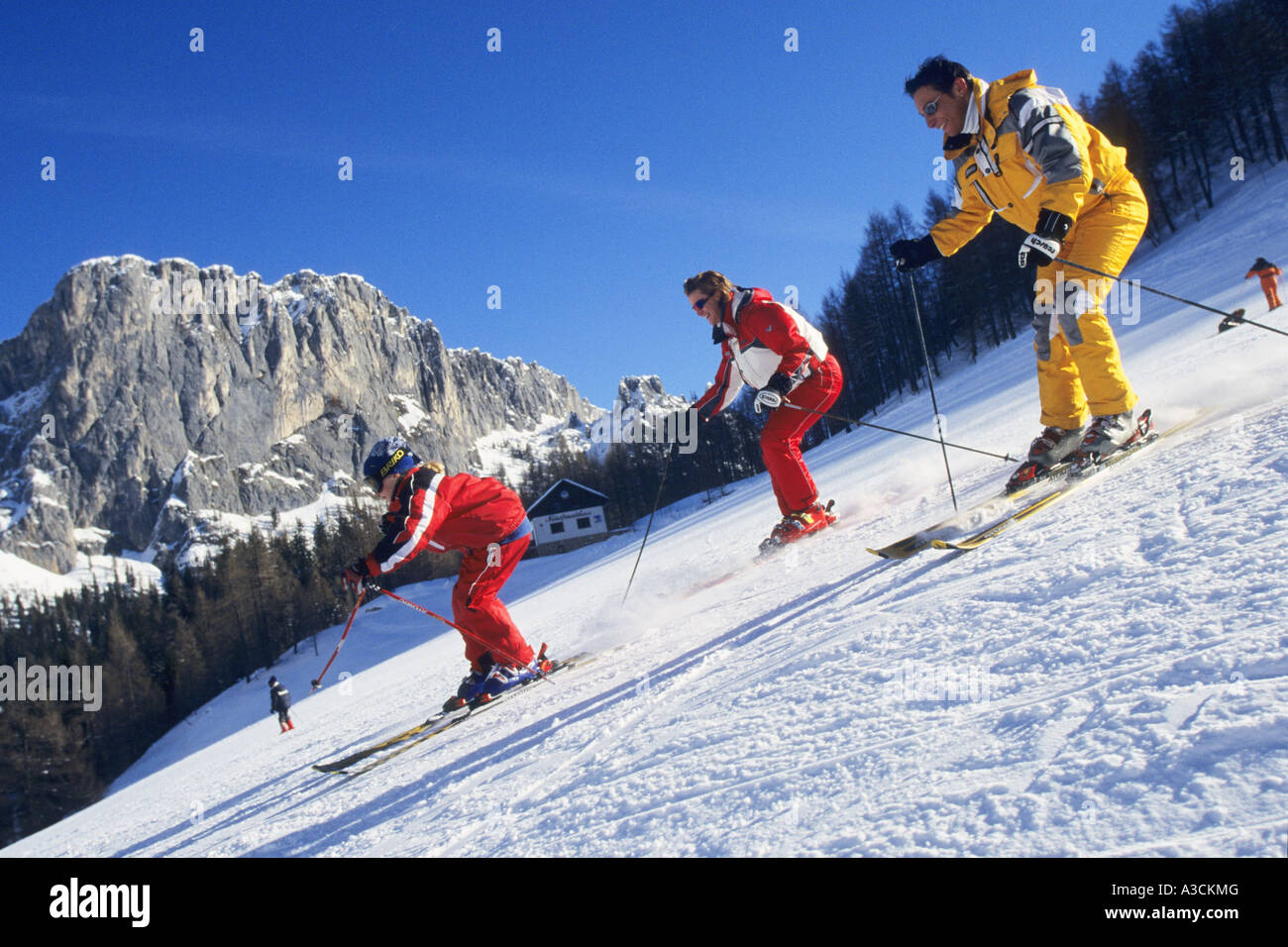 three skier running downhill, Austria, Alps - Stock Image