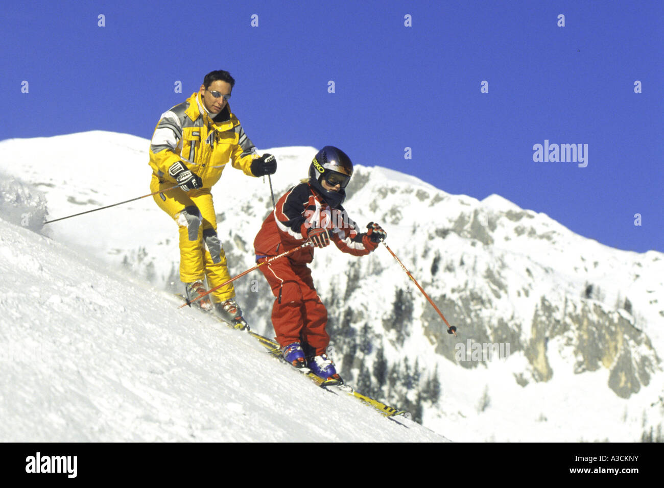 two skier running downhill, Austria, Alps - Stock Image