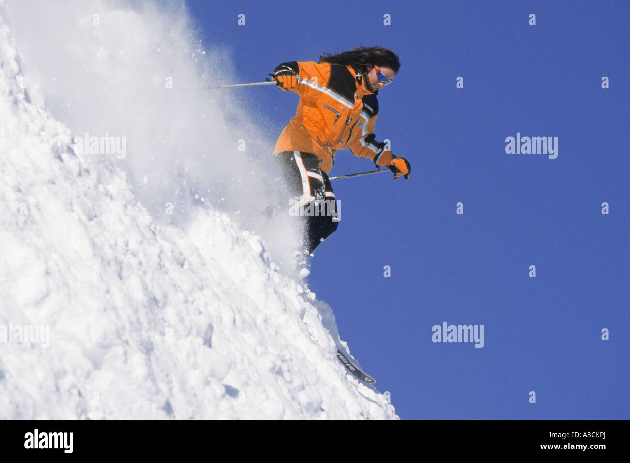 female skier racing downhill, Austria, Alps - Stock Image