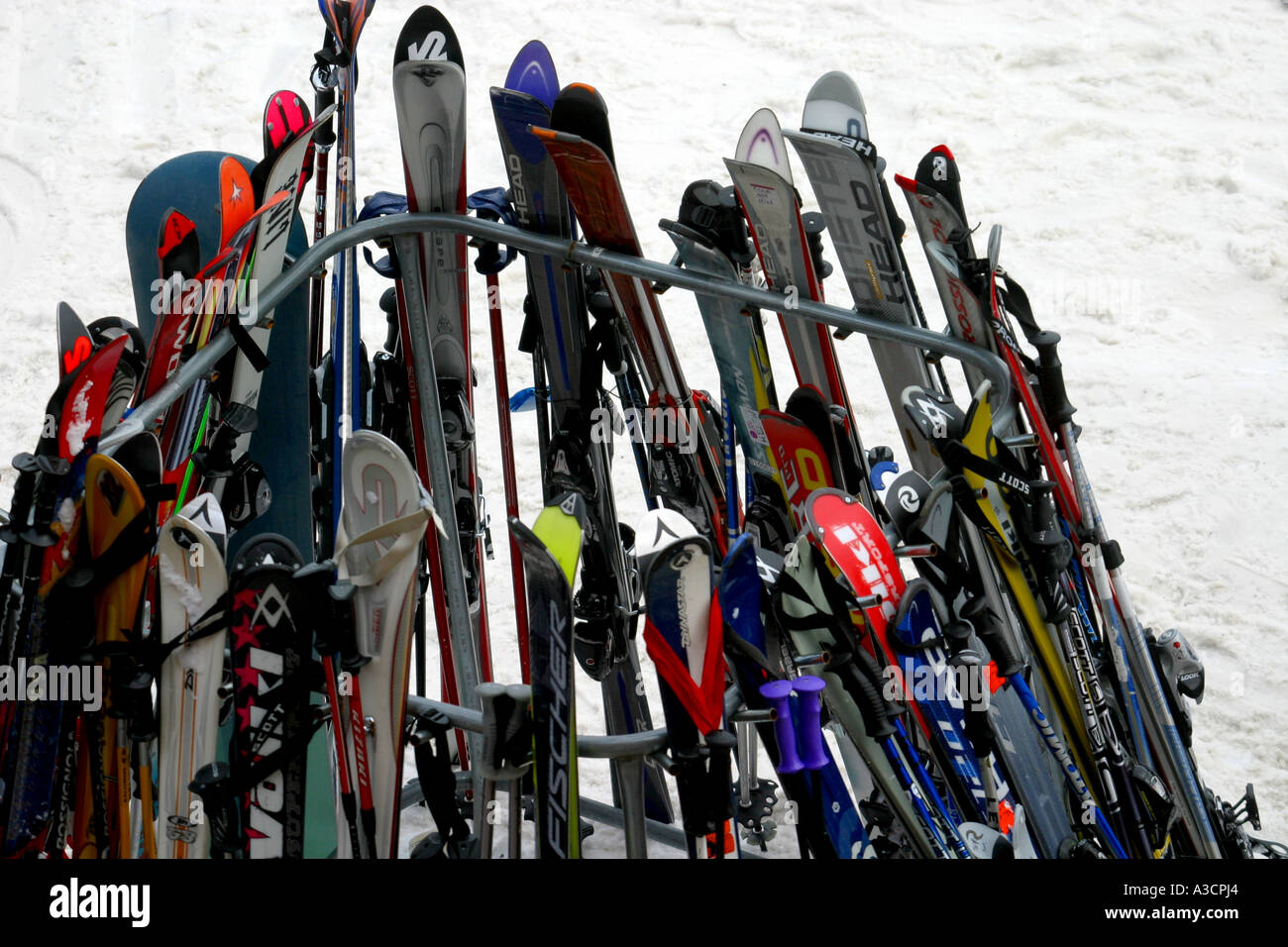 Ski rack full of skis and snowboards Skiing in the Canadian Rockies - Stock Image