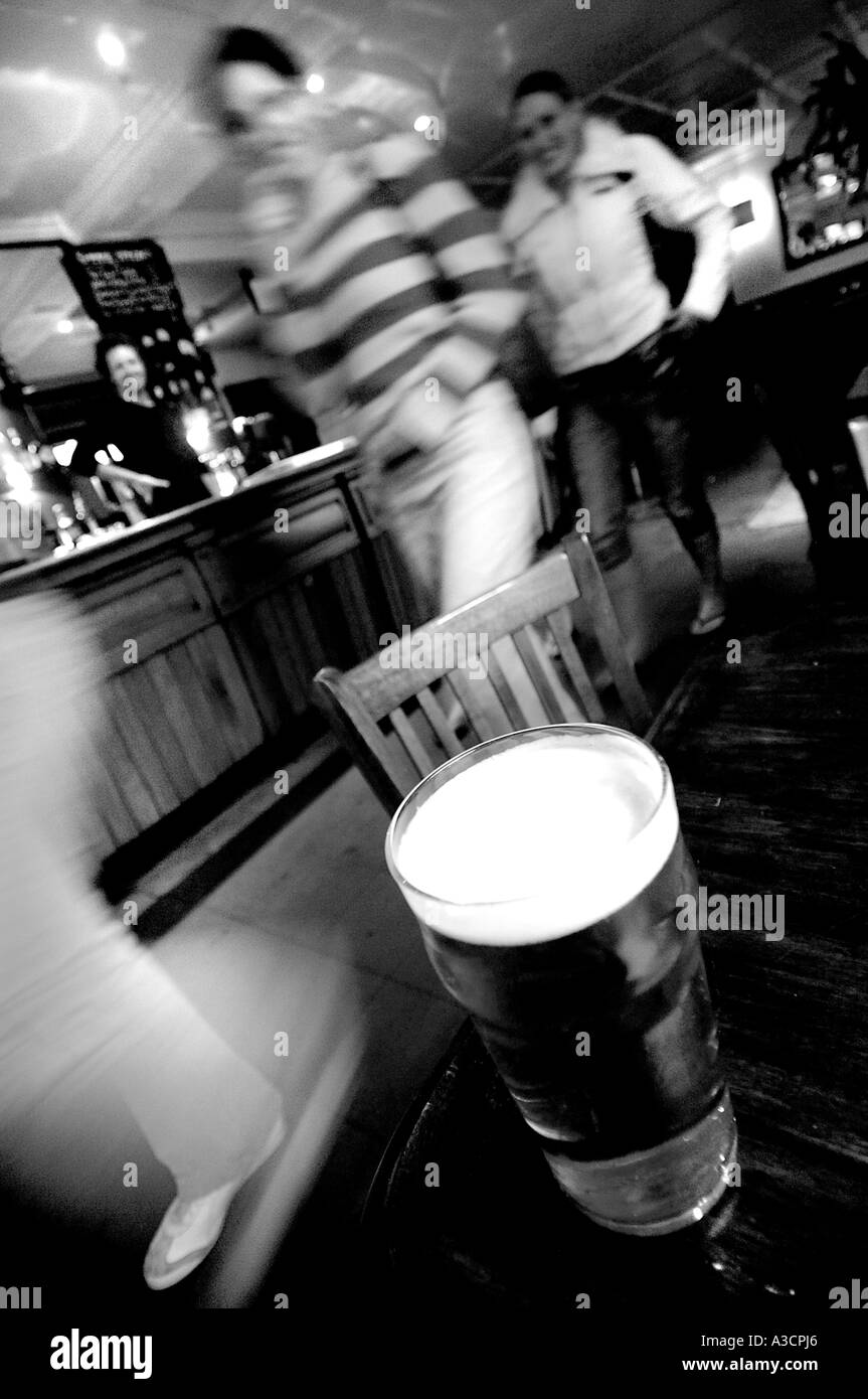 Pint of Beer rests on a table in The Falcon Clapham North London United Kingdom - Stock Image