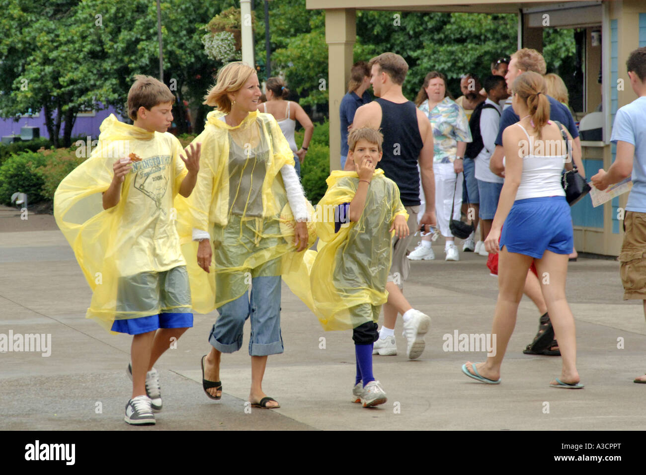 Family wearing rain ponchos on a wet day at Cedar Point Amusement Park Sandusky Ohio OH - Stock Image