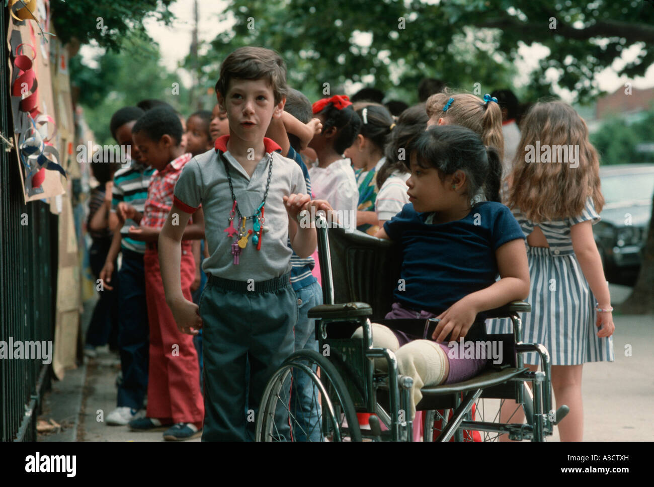 Elementary school children at a student art show in Brooklyn New York - Stock Image